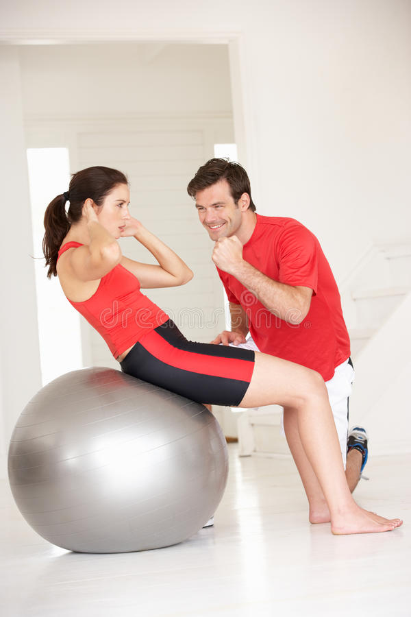 Woman with personal trainer stock image