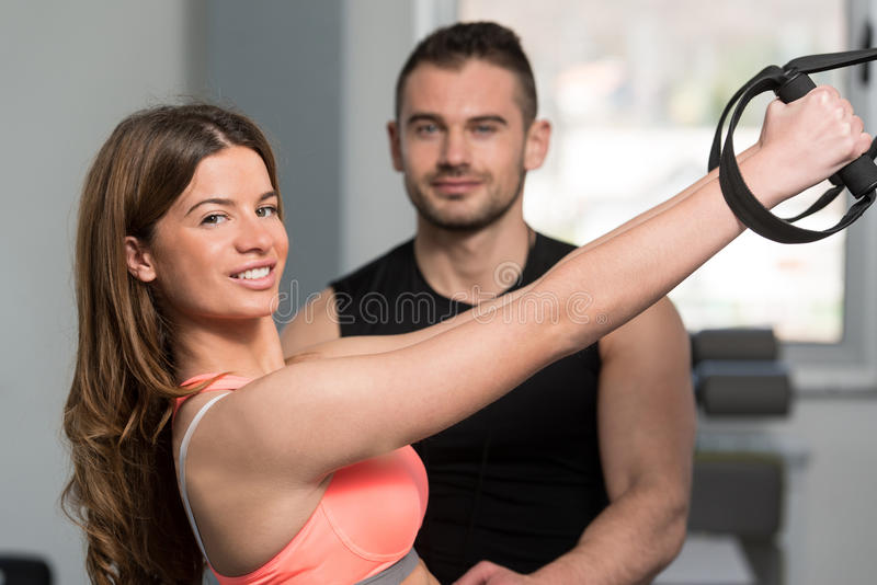 Woman With Personal Trainer Train Trx Fitness Straps royalty free stock photos