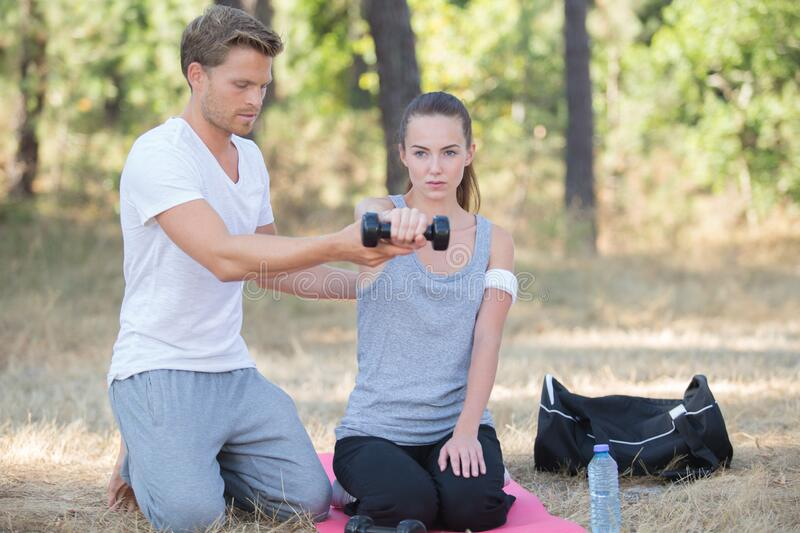 Woman and personal training working out outdoors royalty free stock image