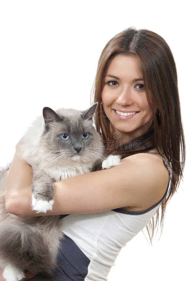 Woman with pet Ragdoll cat smiling. Young pretty woman with pet Ragdoll cat smiling isolated on a white background royalty free stock image