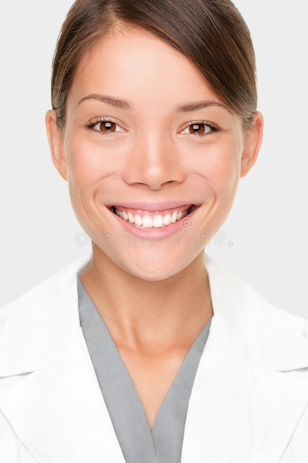 Woman pharmacist. Pharmacist. Portrait of young professional woman pharmacist or scientist in lab coat. Smiling mixed race Caucasian / Asian woman stock photography