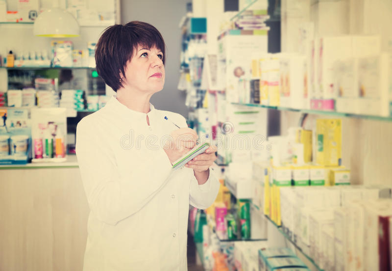 Woman pharmacist in pharmacy royalty free stock images