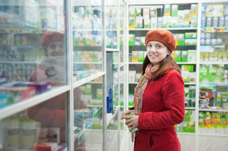 Woman in pharmacy drugstore. Woman near counter in pharmacy drugstore stock photography