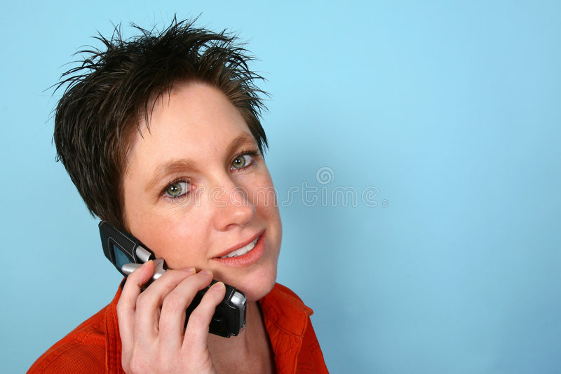 Woman on phone. Young woman talking on her cellphone royalty free stock photos