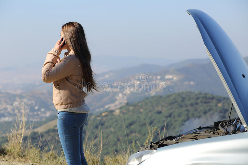 Download Woman On The Phone Beside A Breakdown Car Stock Image - Image: 39076637