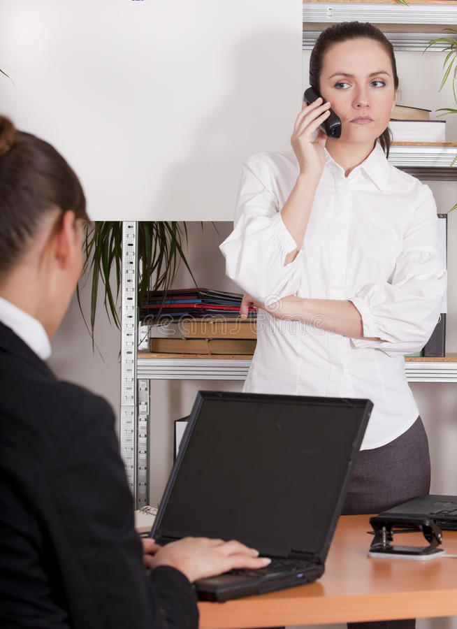 Download Woman On Phone In Office Royalty Free Stock Photography - Image: 11437427