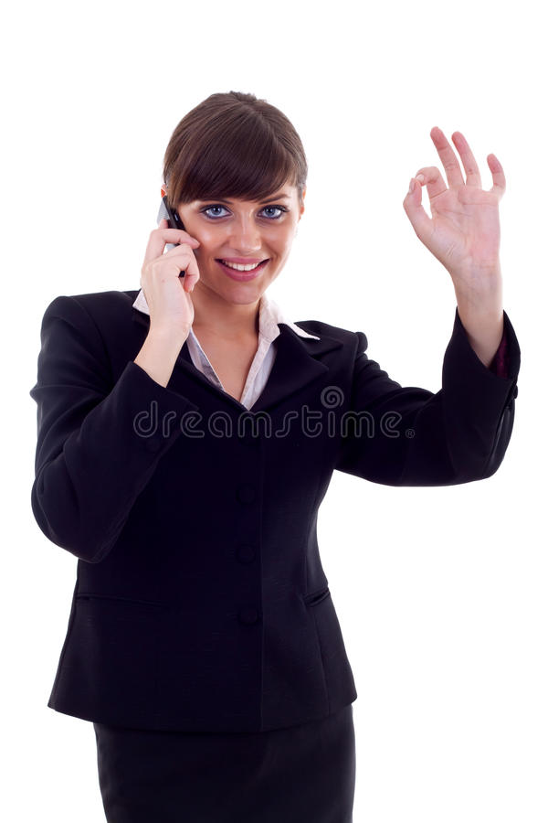 Woman with phone and ok gesture. Happy business woman with phone and ok gesture, isolated stock images