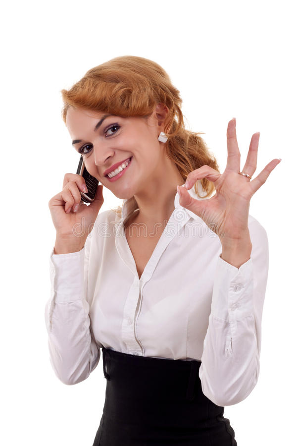 Woman with phone and ok gesture. Happy business woman with phone and ok gesture, isolated stock photos