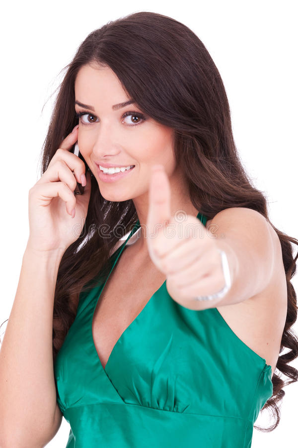 Woman with phone and ok gesture. Happy casual woman with phone and ok gesture, isolated royalty free stock images