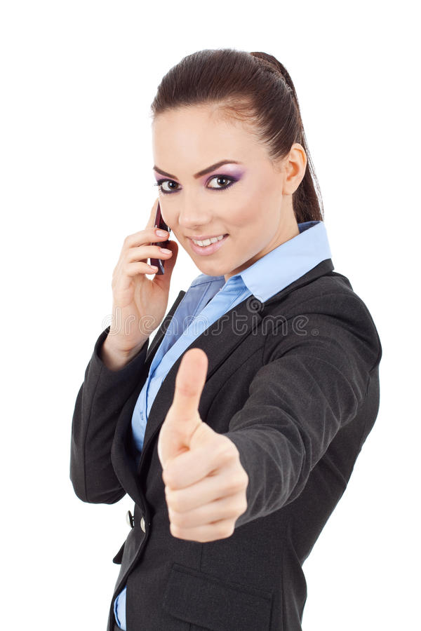 Woman with phone and ok gesture. Happy young business woman with phone and ok gesture looking at the camera, isolated on white royalty free stock image