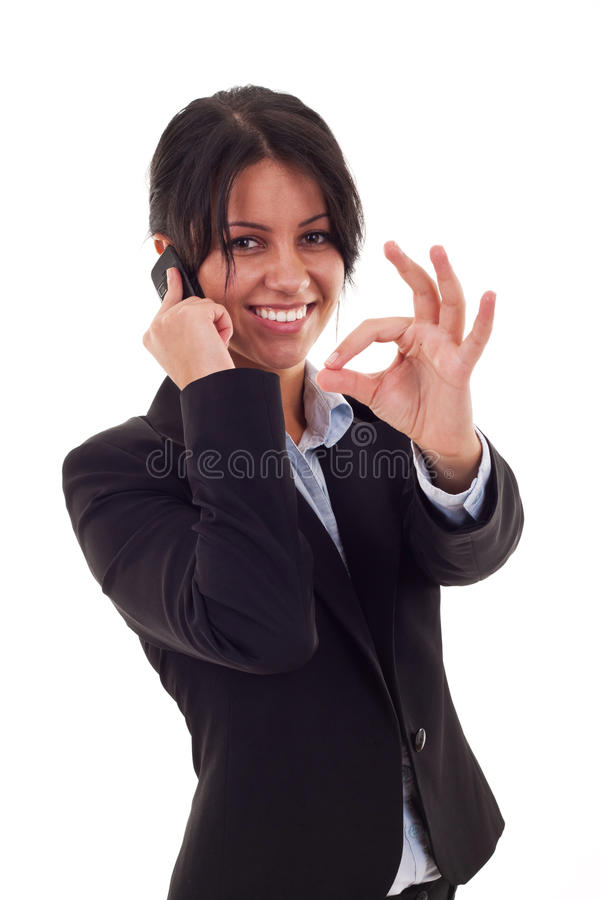 Woman with phone and ok sign. Happy business woman with phone and ok gesture, isolated stock photos