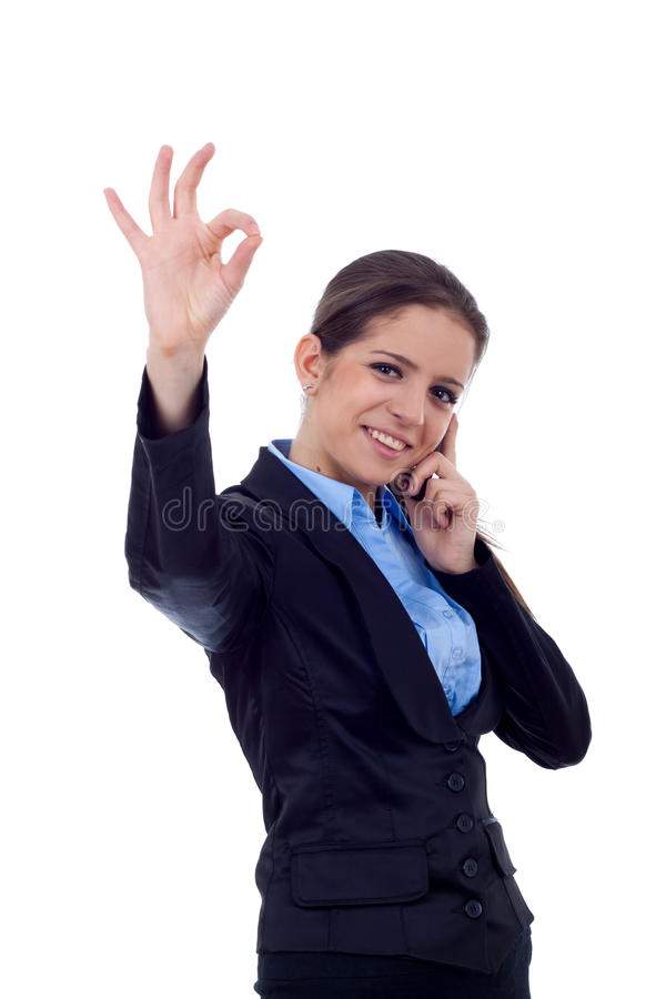 Woman with phone and ok sign. Happy business woman with phone and ok gesture, isolated stock images