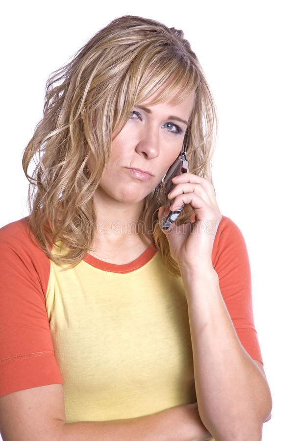 Woman on phone scowling
