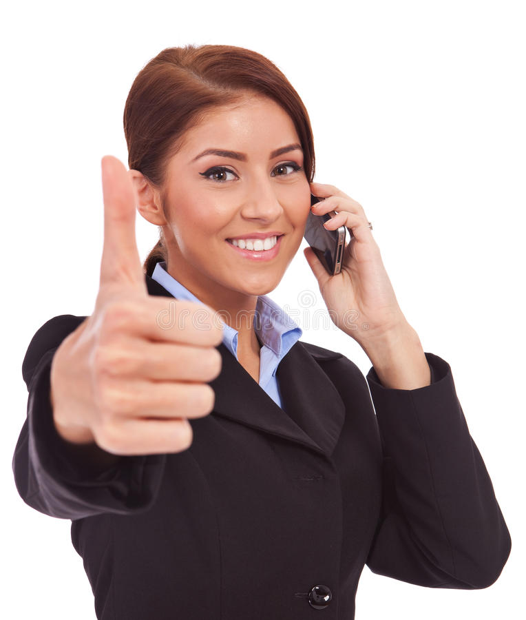 Woman with phone and thumbs up gesture. Happy business woman with phone and thumbs up gesture, isolated royalty free stock photography
