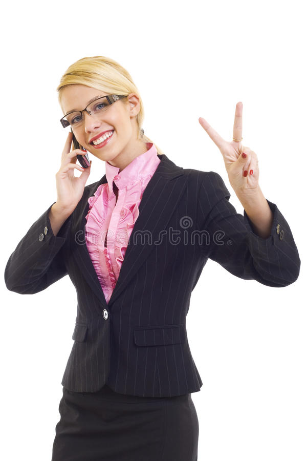 Woman with phone and victory gesture. Happy businesswoman with phone and victory gesture, isolated stock images
