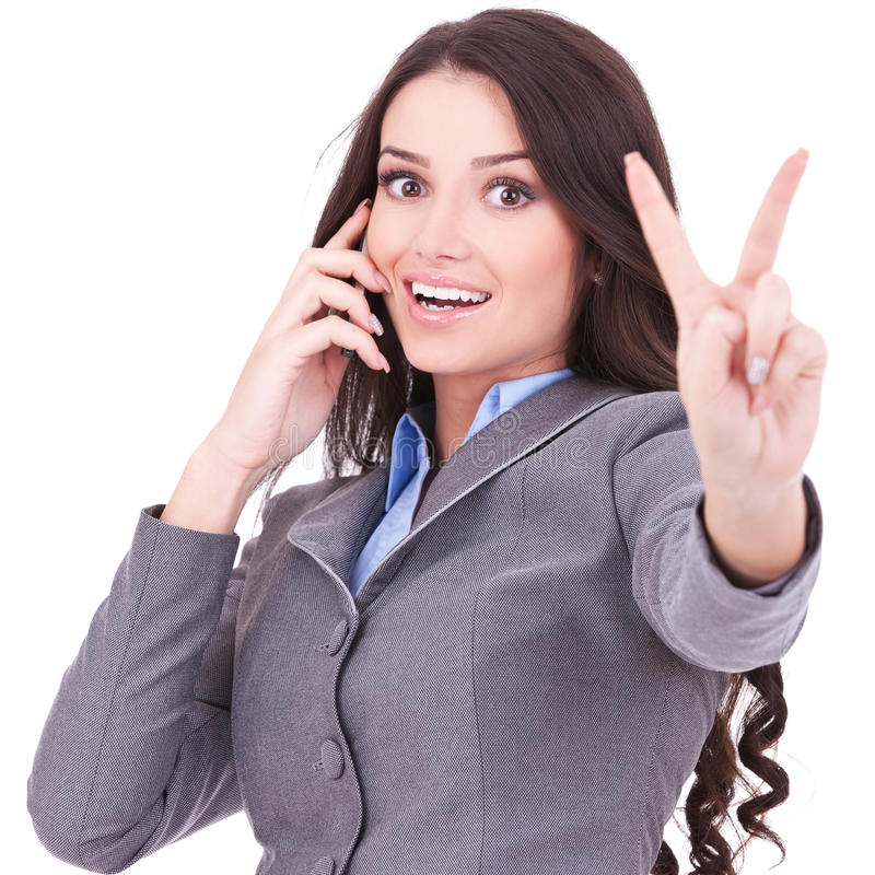 Woman with phone and victory gesture. Happy business woman with phone and victory gesture, isolated royalty free stock photos