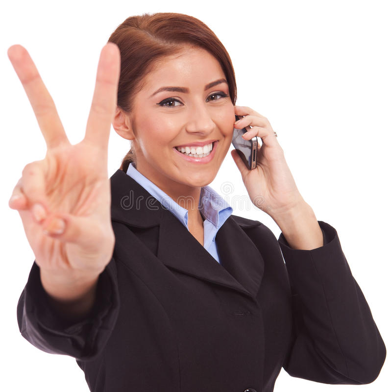 Woman with phone and victory gesture. Happy business woman with phone and victory gesture, isolated royalty free stock photography