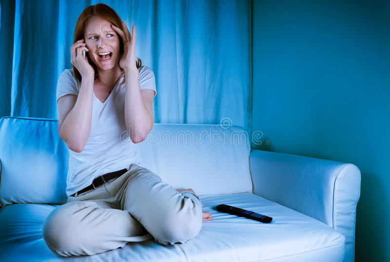 Download Woman On The Phone While Watching TV Stock Photo - Image: 21058118
