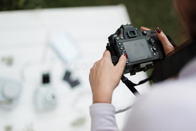 Woman photographer makes photos for stock photography. royalty free stock image