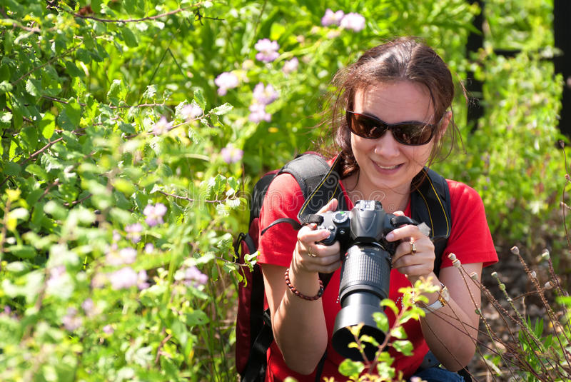 Woman photographer in nature royalty free stock photo