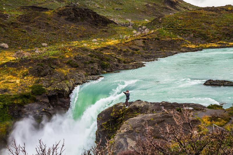 Woman photographer near waterfall Salto Grande stock images