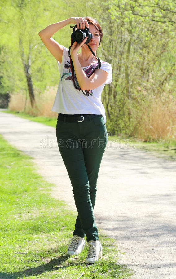 Woman photographer in photo pose stock image