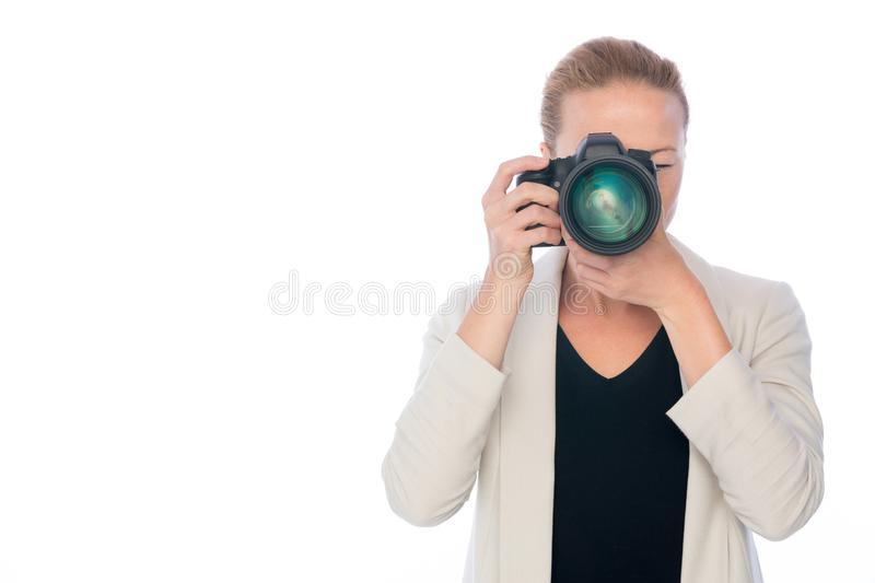 Woman photographer takes images with dslr camera royalty free stock photo