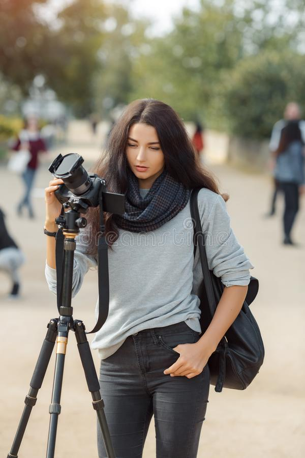 Woman photographer takes images with dslr camera royalty free stock image