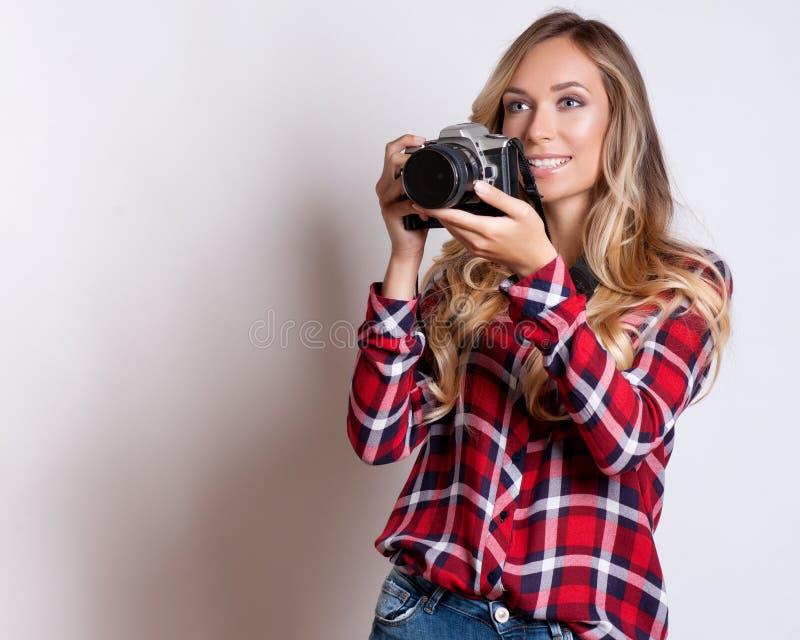 Woman-photographer takes images, on white stock photos