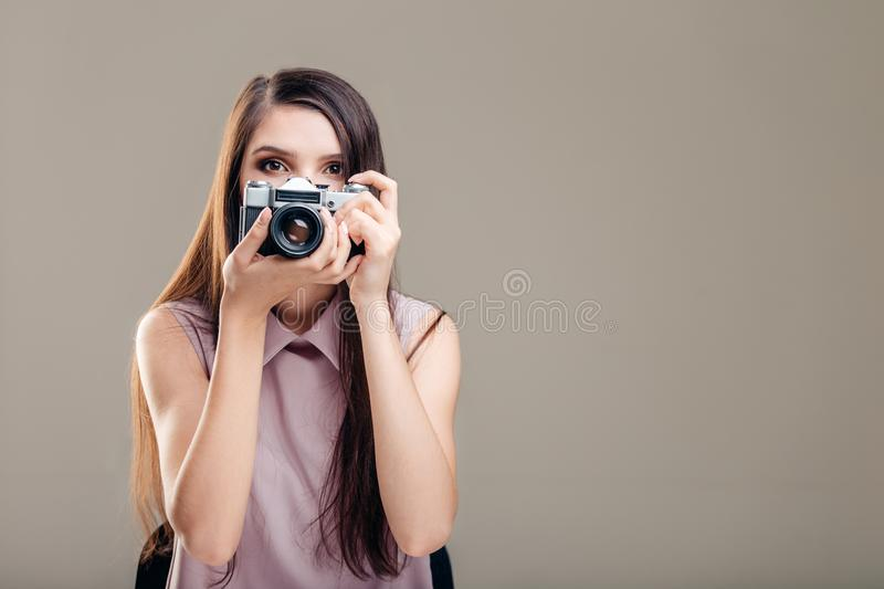 Woman photographer is taking images with dslr camera stock image