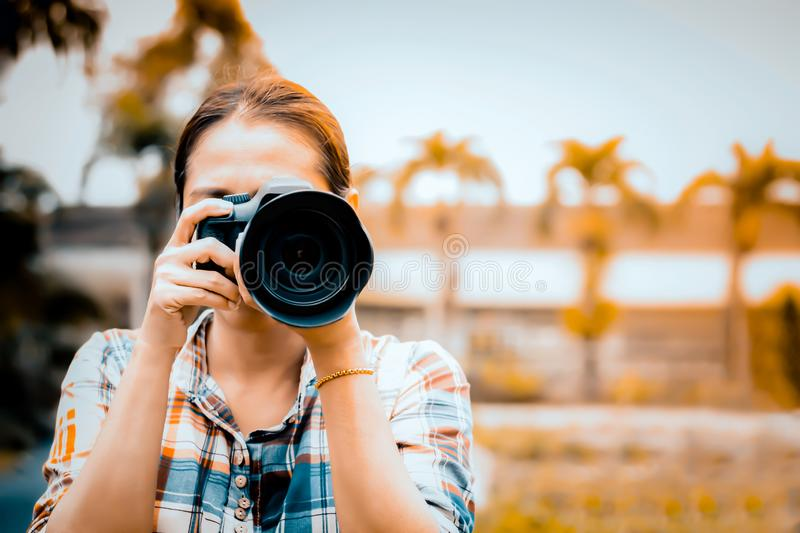 Woman photographer is taking images stock photo