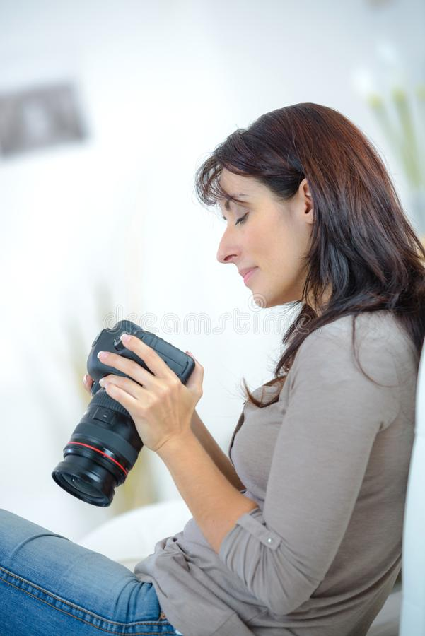 Woman photographer taking images with dslr camera royalty free stock photos