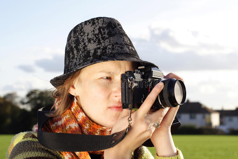 Woman Photographer taking picture stock image