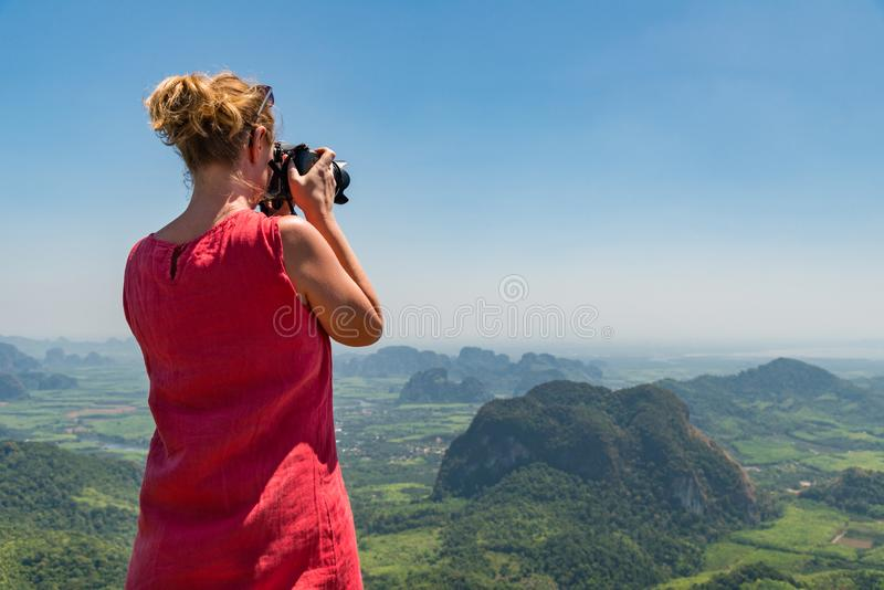 Woman photographer taking picture royalty free stock images