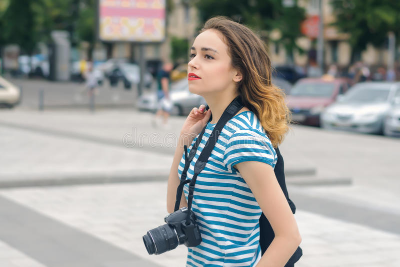Woman photographer walking down the street royalty free stock images