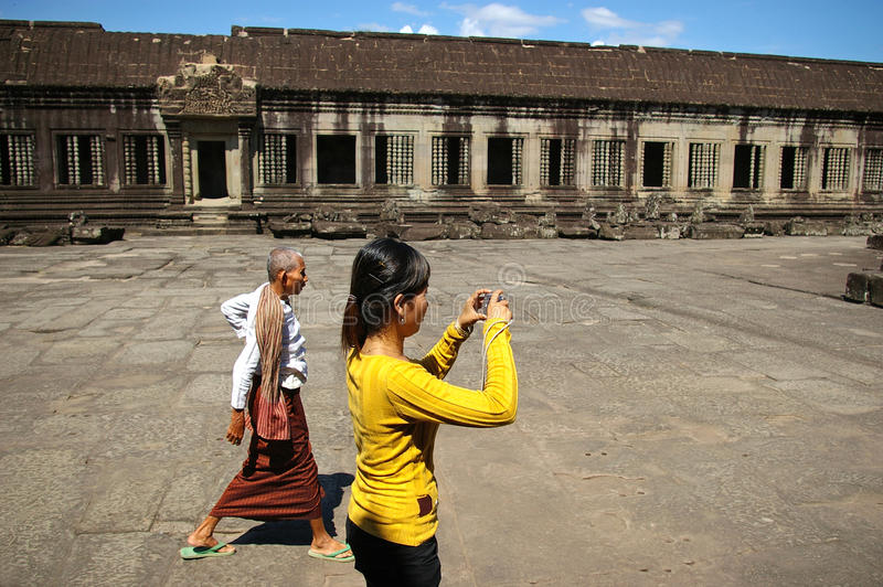 Woman photographing Angkor Wat