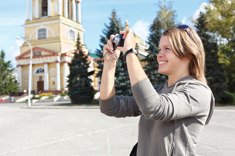 Woman photographing city s attractions