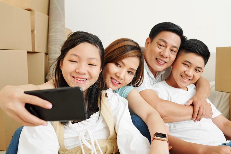 Woman photographing with family royalty free stock images