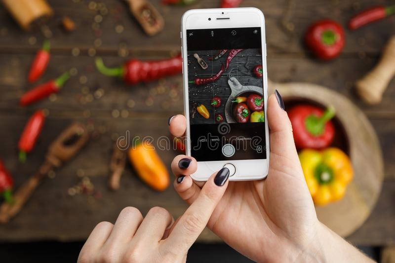 Woman photographing food by phone stock photo