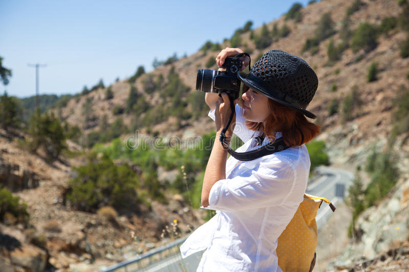A Woman Is Photographing A Nature Stock Image