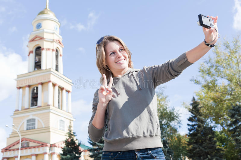 Woman Photographing Themselves Stock Image