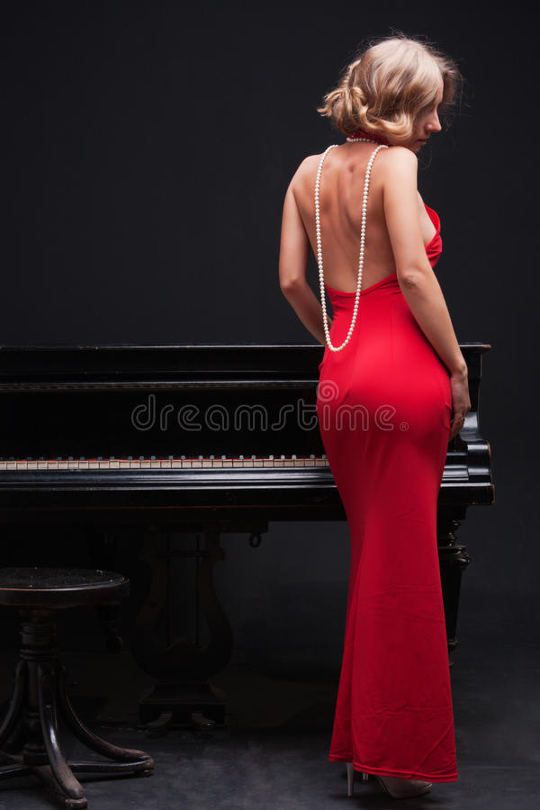 Woman and piano stock photo