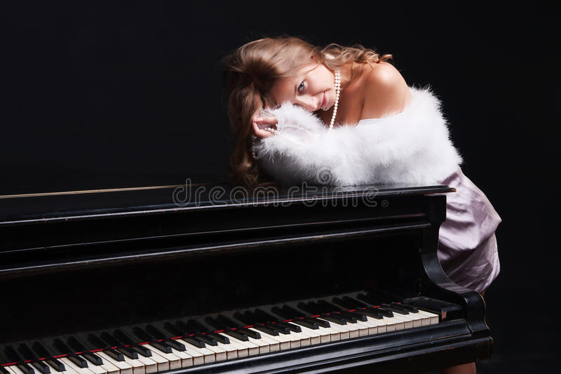 Woman and piano royalty free stock photos
