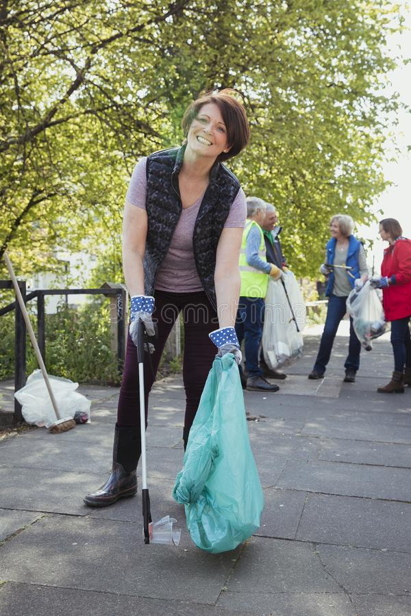 Woman Collecting Litter stock image