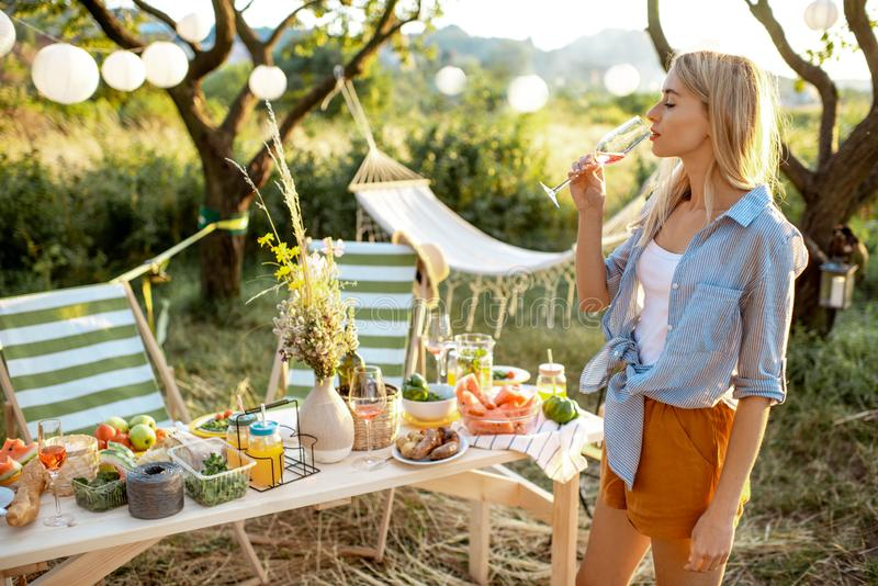 Woman on a picnic in the garden royalty free stock images