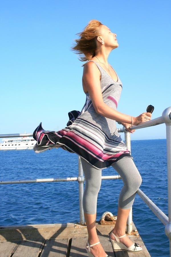 Download Woman on pier stock image. Image of blue, modern, horizon - 12394619