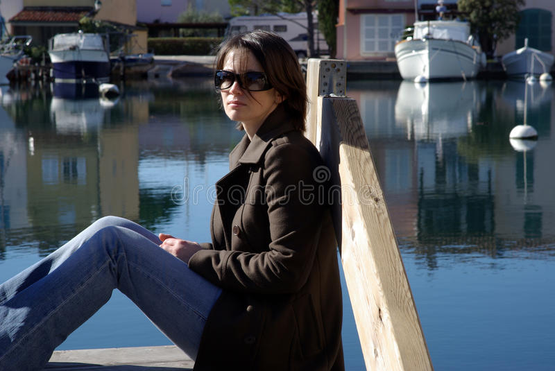 Woman at pier royalty free stock photography
