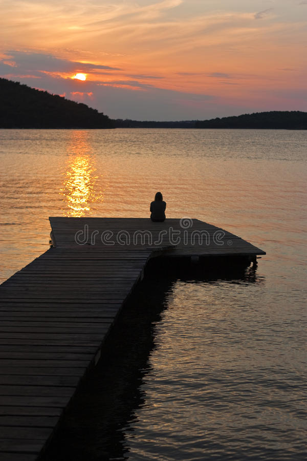 Download Woman on pier with sunset stock photo. Image of orange - 16065204