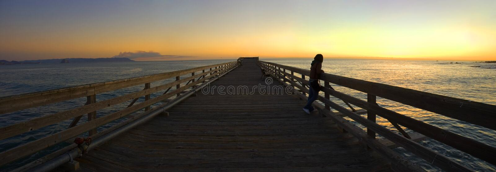 Woman On A Pier During Sunset Royalty Free Stock Photography