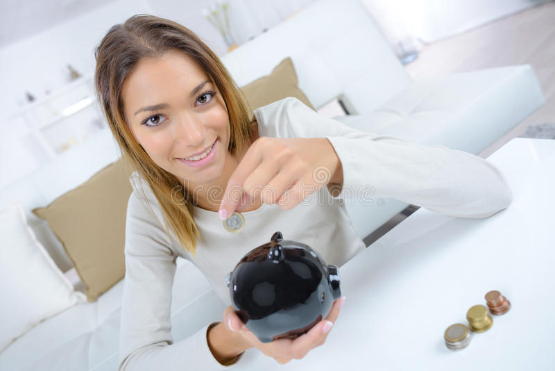 Woman with piggy bank stock image